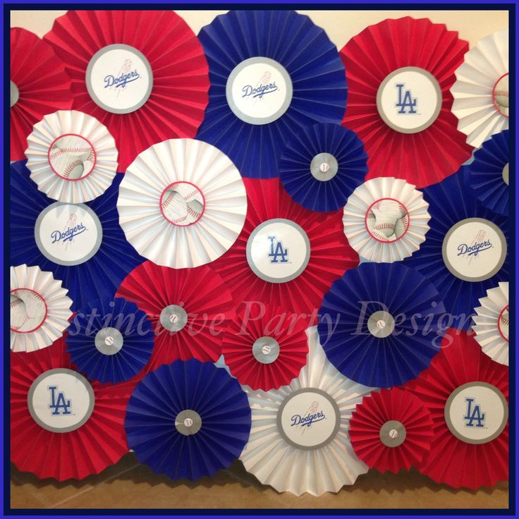 Custom designed pinwheel backdrop for baseball (Dodgers) inspired birthday party. Created by Distinctive Party Designs.