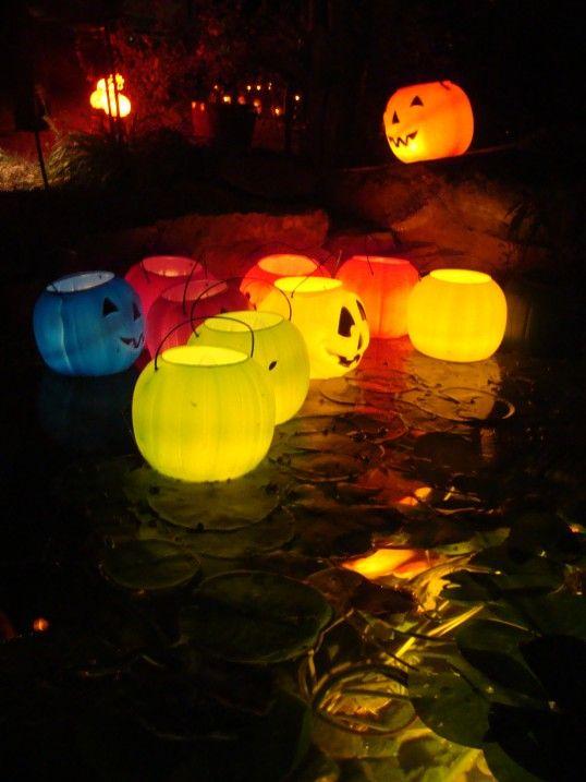 Put LED tealights in plastic jack-o-lantern buckets if you have a pond! More at LightsOnline Blog