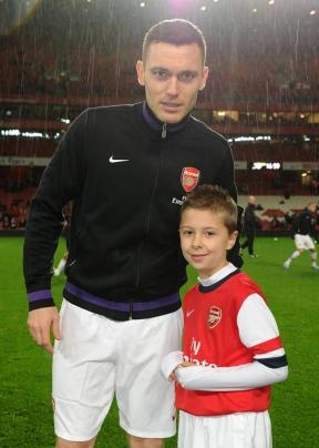 A schoolboy mascot who led Arsenal football team on to the pitch ahead of their recent 7-3 win over Newcastle United has spoken of his delight at being picked for the honour.    Luke Hughes, seven, of North Birkbeck Road in Leytonstone, was selected at random out of 25,000 other children in the 'Junior Gunners' supporters club for the once-in-a-lifetime opportunity.
