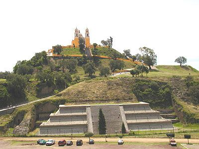 The church here lies ontop of the great pyramid of Cholula. which is overgrown.