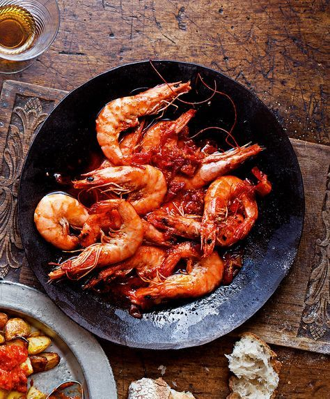 Try this easy recipe for garlic and chilli king prawns as part of a Spanish tapas dinner party.