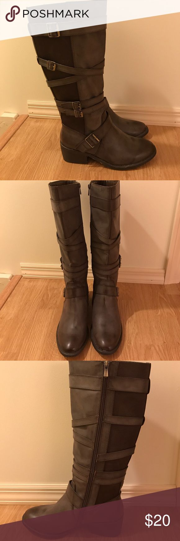 Enigma tall brown boots Enigma tall brown boots with straps. Unworn. Size UK 39 (US 9) Enigma Shoes Heeled Boots