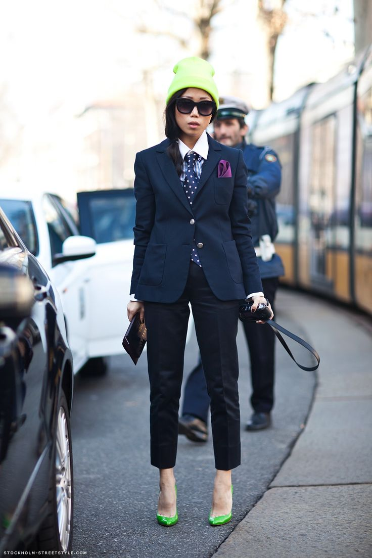 neon green, polka dotted tie.. Who is this woman with amazing style?