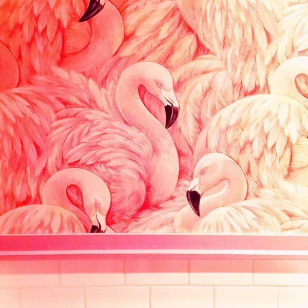 Flamingo wallpaper in a NYC restaurant bathroom