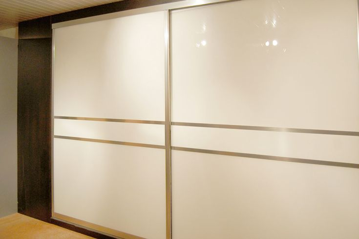 Polished Curved Frame with Pearl White Glass. Design your own Sliding Wardrobe Doors here: http://www.diyhomefit.co.uk/bedrooms/sliding-wardrobe-doors-designer.html