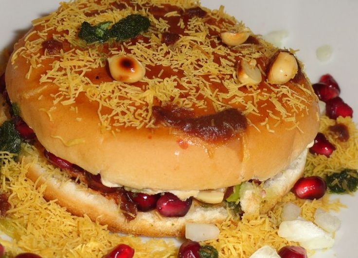 Dabeli is a very popular spicy snacks item made by boiled potatoes with a special dabeli spices and putting the mixture between the pav.