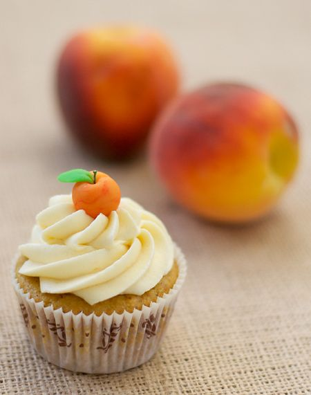 Peach Bourbon Cupcakes recipe.  I love the little marzipan peach on top! Recipe found at Love and Olive Oil, from July 12, 2010.