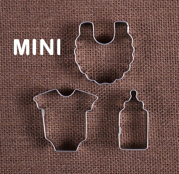 Use our mini baby cookie cutters for making tiny sugar cookies! This set comes with a bottle, onesie and bib cookie cutter. These are very little so they are perfect to use for cutting out fondant to