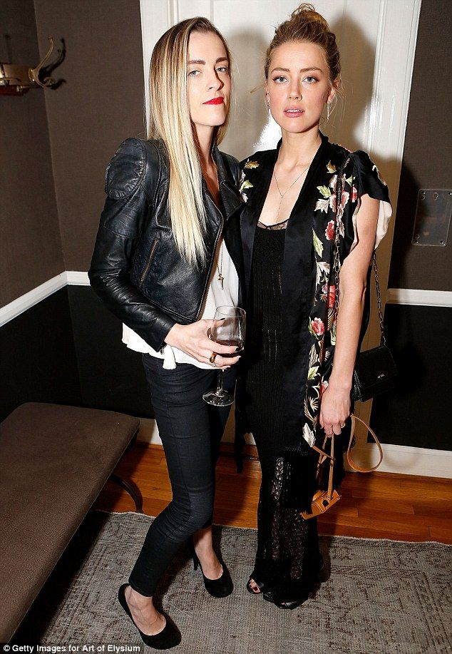 A real sister act: Amber Heard and her husband are never far from each other's side, she proved she's still got time for the rest of her family, as she attended an art event with sister, Whitney, on Saturday night