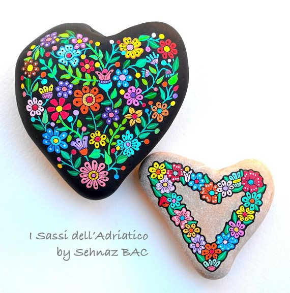 Hand Painted Stone (Adriatic sea) Flower Heart Beach stone with hand-painted designs in acrylics © Sehnaz Bac 2017  I paint and draw all of my original designs by hand with the small brushes or paint pens with extra fine tip. I use also different inks. No stencils are used. All