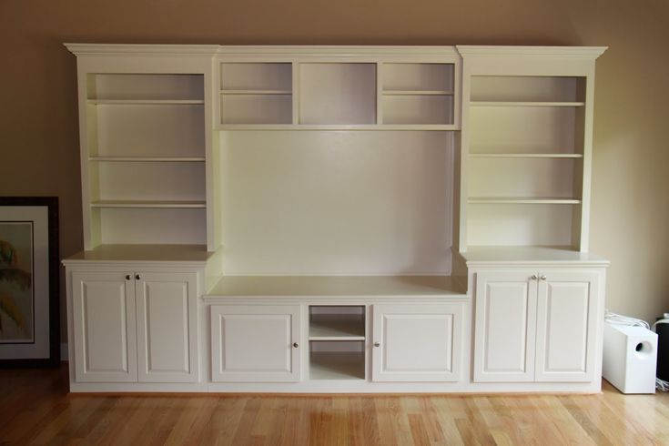 built in bookshelves with TV in drywall | center is custom built using six different pieces it is built ...