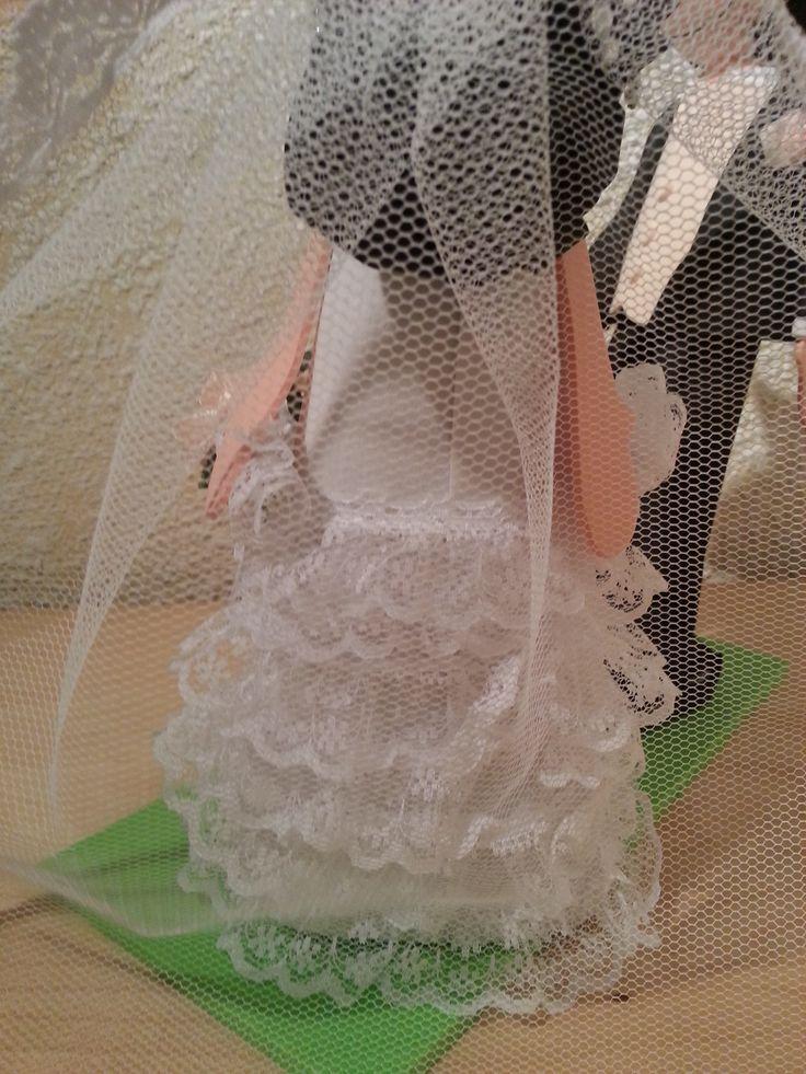 peinado, parte de atras del vestido, velo amantillado