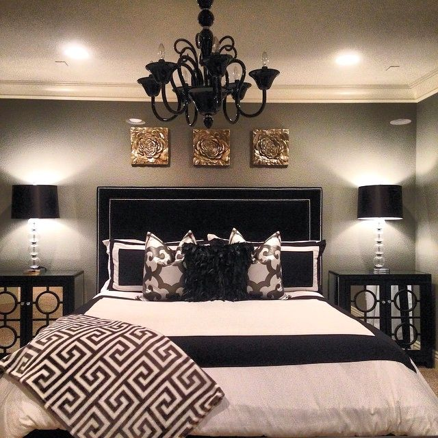 shegetsitfromhermamau0027s bedroom is stunning with our kate headboard calais chandelier mykonos throw white bed black furniture