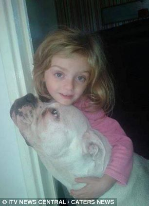 Nanny dog...The family of Lexi Branson (pictured, above, with the dog which attacked her) have said the four-year-old will never be forgotten
