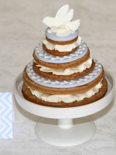 Beautiful dove topped cookie at a Baptism!  See more party ideas at CatchMyParty.com!  #baptism #partyideas