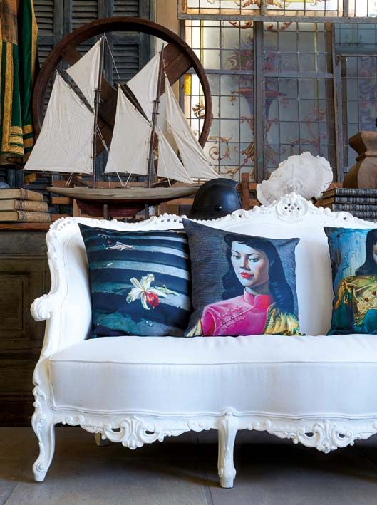 Use Tretchikoff printed cushions to add colour to a white couch.