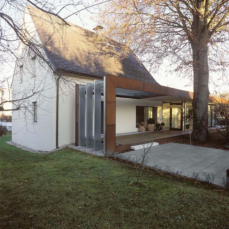 Xarch Folded Corten A Old House Extension Project
