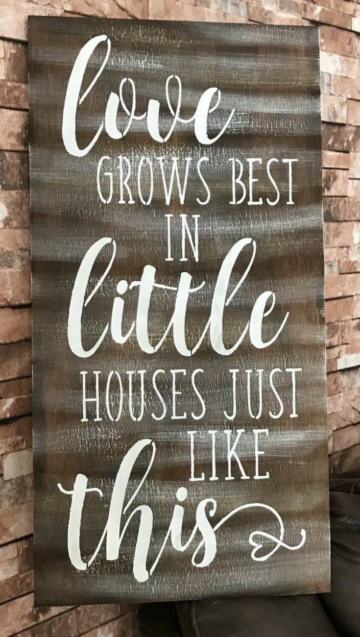 Love grows best in little houses just like this wood sign gallery