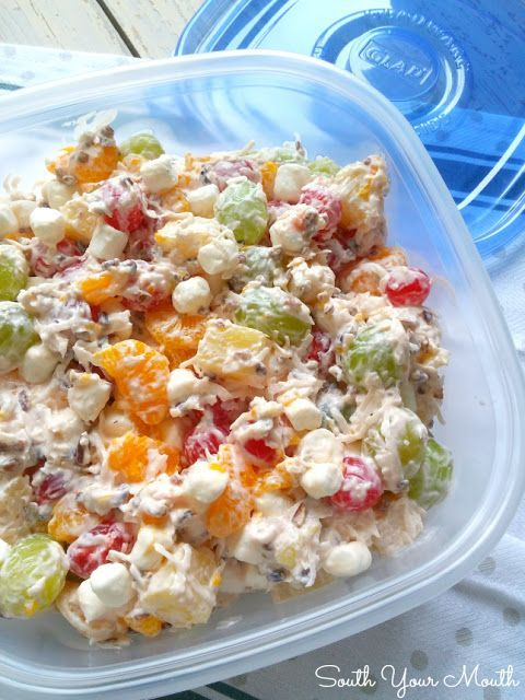 Ambrosia Fruit Salad! This retro fruit salad is simple and perfect with pineapple, mandarin oranges, cherries, green grapes, pecans, coconut and sour cream.