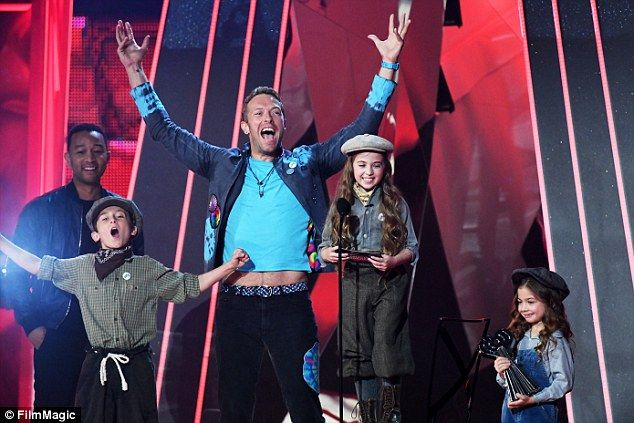 This magic moment: Chris Martin, 40, had a trio of children deliver an acceptance speech o...