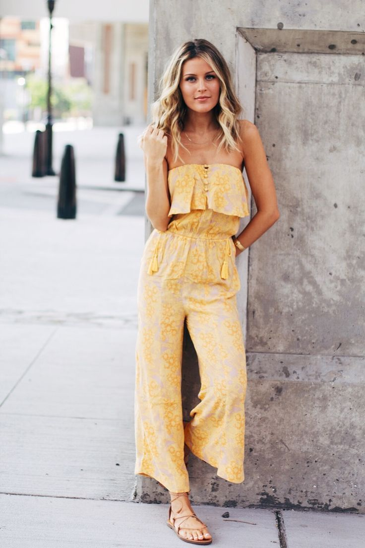 Yellow jumpsuit and tan leather lace up sandals