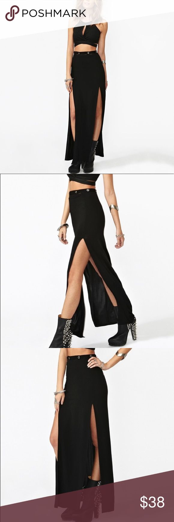 Nasty Gal Black Long Maxi Skirt Rayon Slit XS NWOT NWOT. Never worn. Beautiful Nasty Gal Surrender Maxi Skirt Black long full length 2 slits button high waist. The top of the skirt has a detachable strip with buttons that keep it in place like a suspended belt. There is a gap between the top of the skirt and the bottom of this belt which would show some skin through. 2 long thigh slits that are super sexy. No lining. Size XS Nasty Gal Skirts Maxi