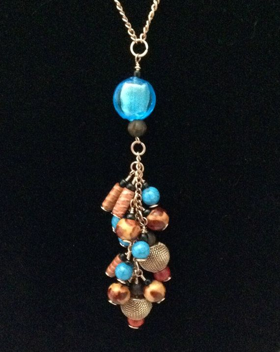 Blue, Red, Copper and Multiple Wood Colours Create a Fun Boho Cluster Drop Necklace