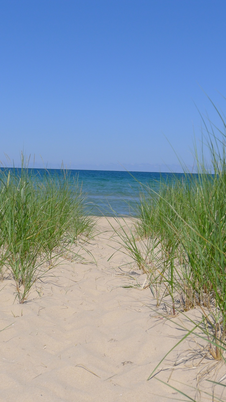 i spent many days on the beaches of lake michigan as a kid and still love to visit it today as
