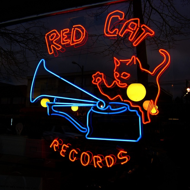 Red Cat Records, great neon sign on Main Street in Vancouver, BC, Canada (2011 by Gord McKenna, via Flickr)