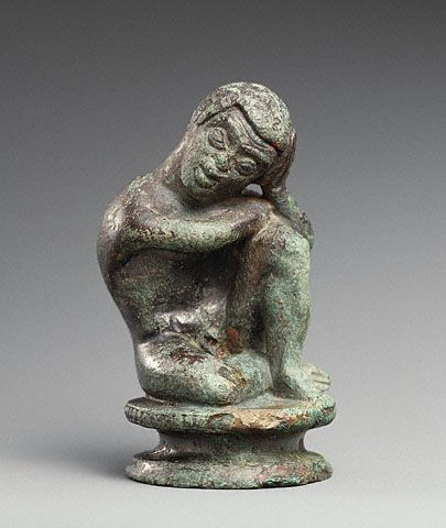 """Statuette of a Slave  Etruscan, 500-400 BC  The J. Paul Getty Museum  """"Resting his head in his hand, a young boy sits curled up on the ground. Through the rendering of hair and facial features, the artist characterized him as an African. The artist also carefully portrayed his poor physical and emotional condition: hunched back, prominent ribs, and dejected posture.  Etruscan traders and sailors would have encountered Africans in their overseas trading. The Etruscans also kept slaves, some…"""