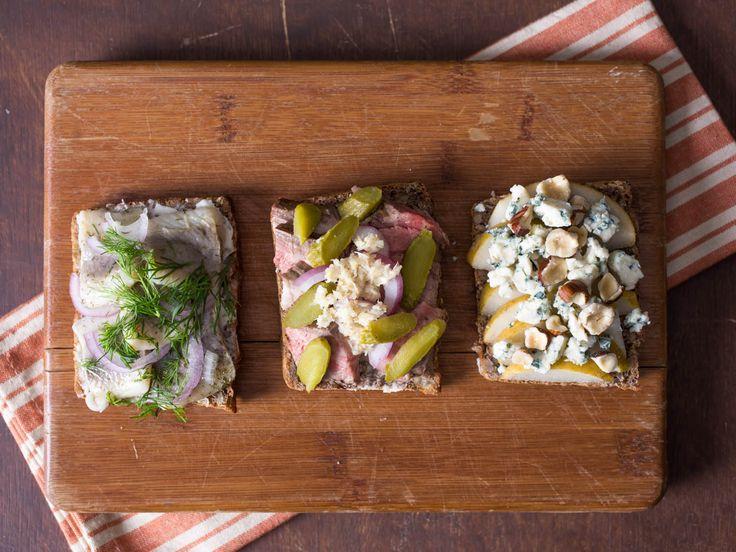 Three classic smorrebrod: pickled herring, roast beef and bleu cheese.