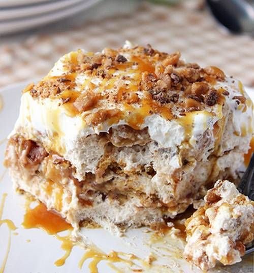This Apple Pie Lasagna is layers of graham cracker, caramel brown sugar cream cheese and whipped cream. Topped with toffee sprinkles.