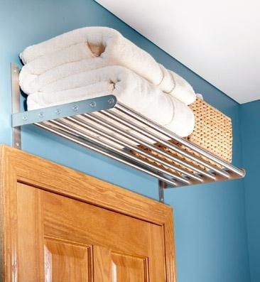 Creative storage for small bathrooms...above the door.