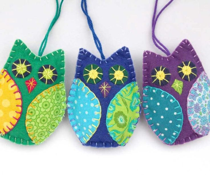 Colorful owl Christmas ornaments, handmade from felt and cotton prints with hand embroidered details. Each owl is 8cm high and has a cotton loop for hanging. Th