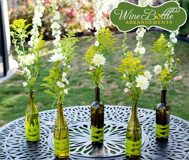Wine bottles with corks (hopefully free!), Ribbon $1.99 or less for 6ft and grocery store flowers.  Add some tea lights. $5.00 each