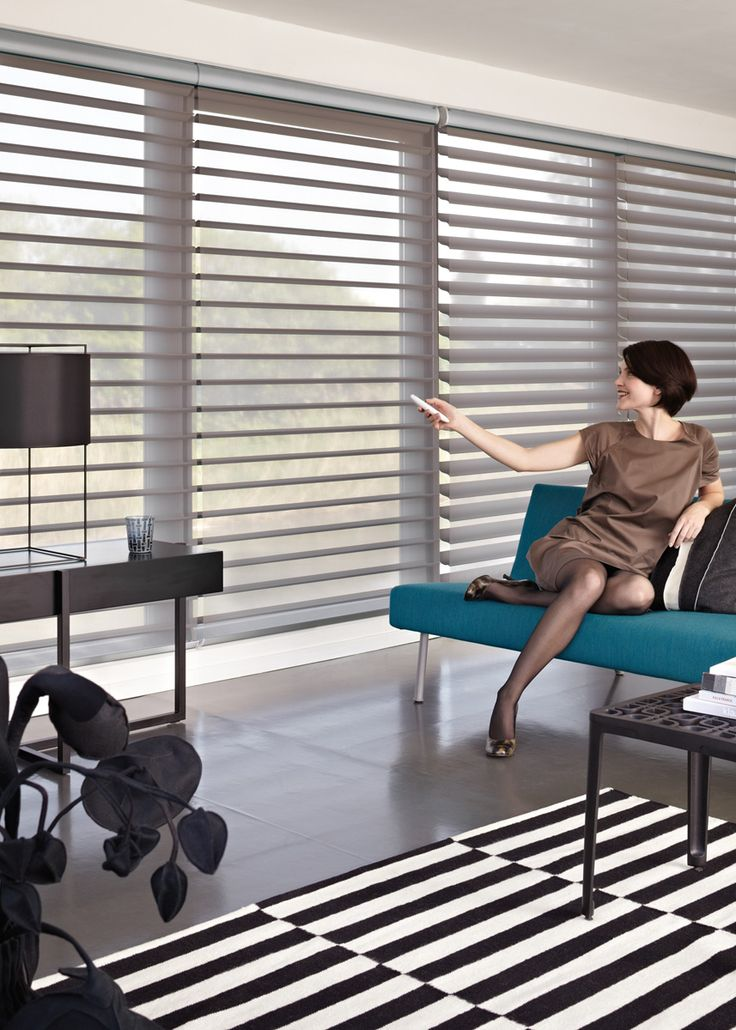Luxaflex® Silhouette® Shades. The unique rotating vanes provide subtle light control and privacy creating an endless variety of moods. #Luxaflex #SilhouetteShades #SmartHome #Blinds