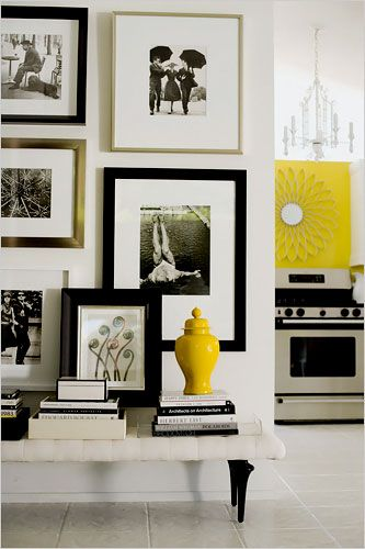 Chic Gallery Wall with lovely bench stacked with books....great idea for an entryway or Hallway or focal wall in living room.