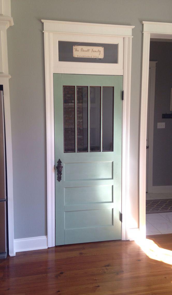 Repurposed painted pantry door.