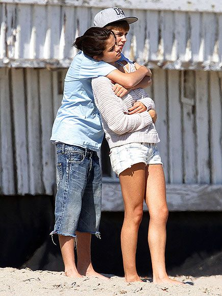 Selena Gomez being hugged by Justin Bieber at a Malibu beach on September 23, 2011.