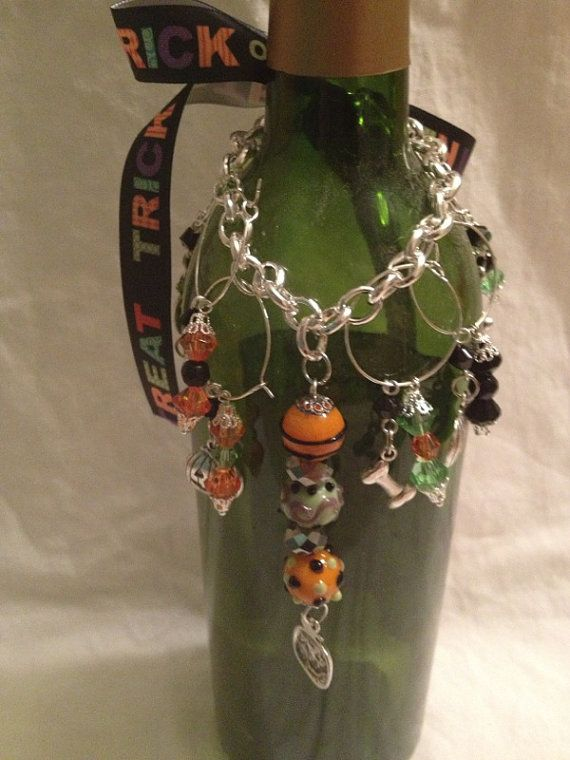 """CLEARANCE! Great gift - Wine bottle """"necklace"""" complete with 6 Halloween wine charms and a central decorative pendant"""
