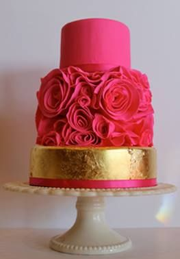 This hot pink and gold cake would brighten any wedding reception