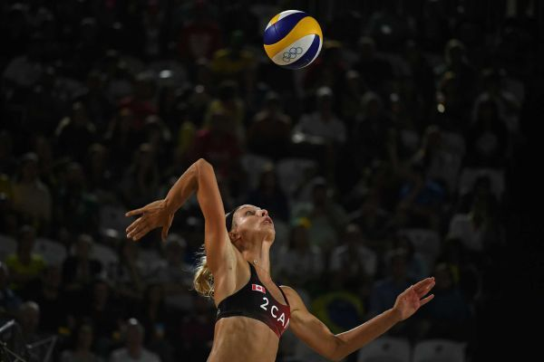 Canada's Kristina Valjas serves during the women's beach volleyball qualifying match between Italy and Canada at the Beach Volley Arena in Rio de Janeiro on August 7, 2016, for the Rio 2016 Olympic Games.