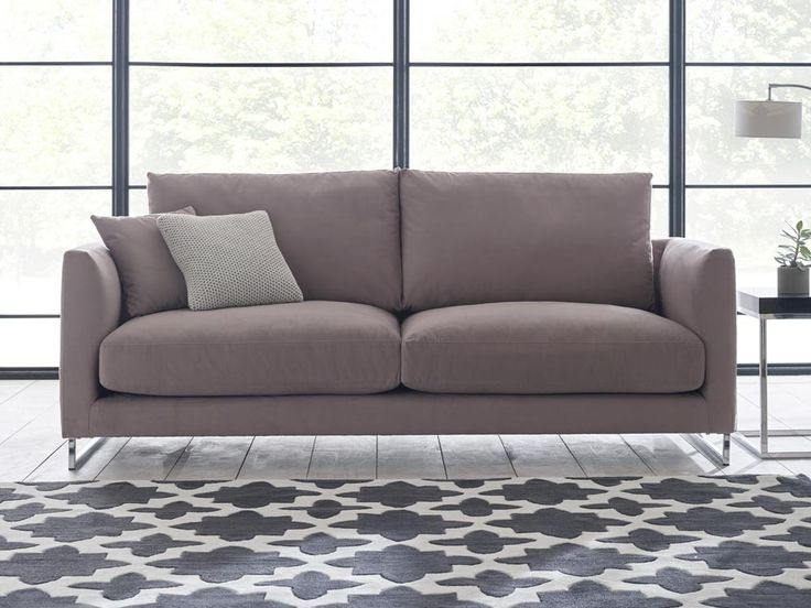 Darcie Sofa - A seemingly simple design is lifted by metallic sleigh feet that add a contemporary touch to a classic look - by www.livingitup.co.uk