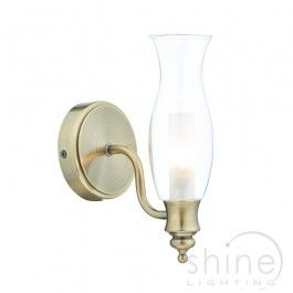 Vestry VES0775 1 Light traditional wall light by  Dar Lighting. Traditional wall light in antique brass with clear glass shade.   Double Insulated (Class II)  1 x 25w G9 Halogen bulbs (Included)  Height: 220mm  Width: 100mm  Depth: 140mm  IP44 rated. (Suitable for use in bathroom zones 1 & 2) £49.00