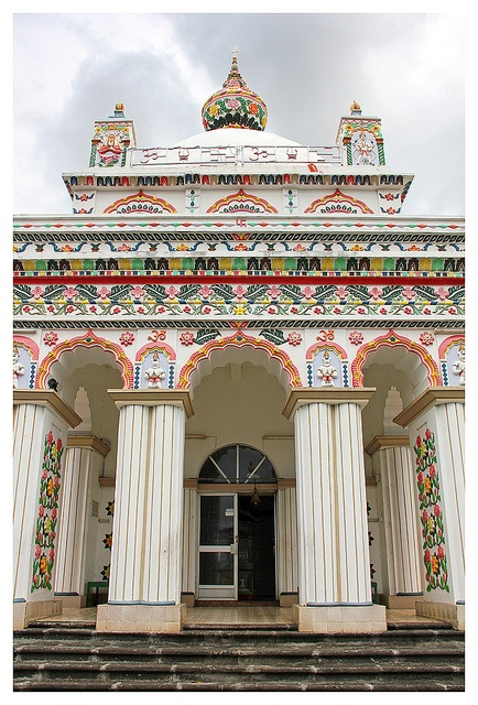 Speckles and sprinkles of color over white are festive decoration to behold. Mauritius - The Maheshwarnath Mandir hindu temple inTriolet #Mauritius #tourism #temple