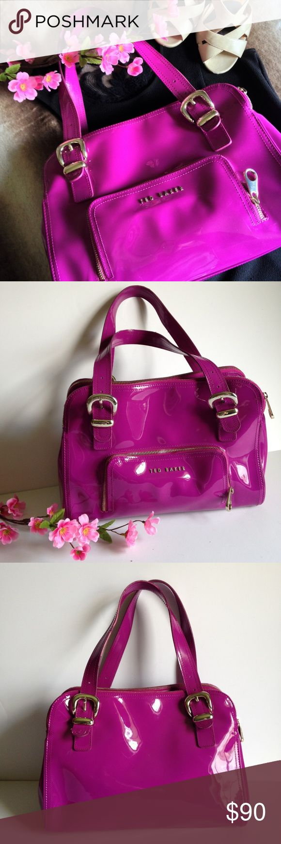 """Ted Baker Fuchsia Vegan Patent Leather Bag Super cute Ted Baker shoulder/hand bag, in fuchsia 100% vegan patent leather. Features front zip pocket, slightly adjustable double straps with buckle detail, top magnetic snap closure, 2 top zip compartments and beautiful black and white floral lining. In good used condition, has some minor wear as pictured. Approximately 14"""" wide, 10"""" tall, 5"""" deep and 8"""" strap drop at the longest. I happily entertain reasonable offers 😊🌸 Ted Baker Bags Shoulder…"""