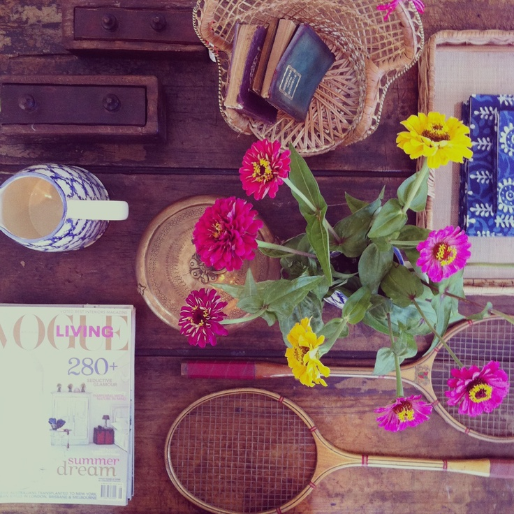 Pretty table top vignette - not cluttered despite so many things on the table
