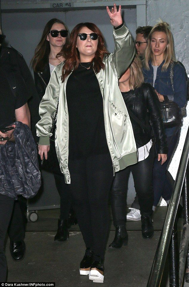 Casual cool: She also sported a black top with matching trousers and leather boots featuri...