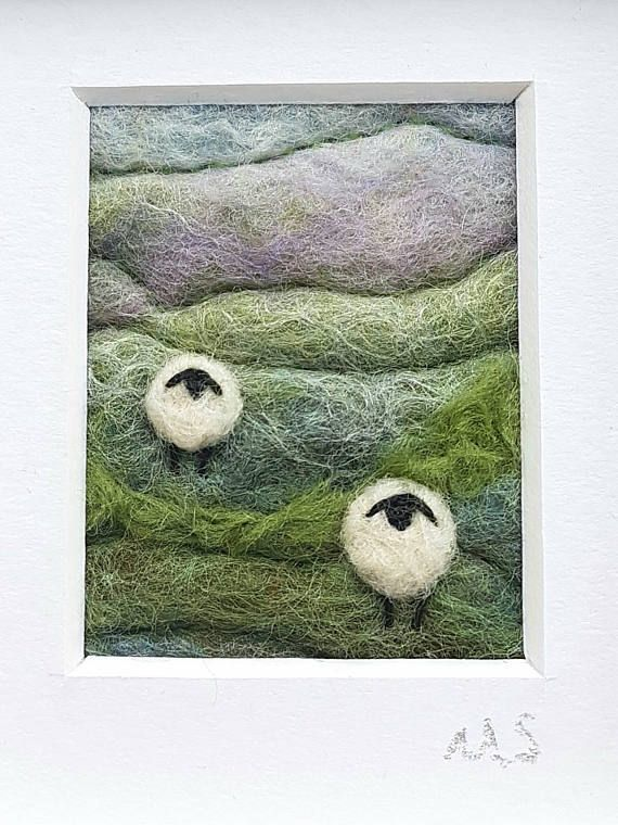 An original piece of textile art by Shropshire-based artist Maxine Smith. A one of a kind needle felted and hand embroidered miniature picture inspired by the natural environment.  This little felted landscape has been created by hand using wet felting and free motion embroidery to create a typical British rolling hillside. Wool and fibres have been added with needle felting. The sheep have been needle felted and embroidered and some stitches complete the piece.  The little felted landscape…