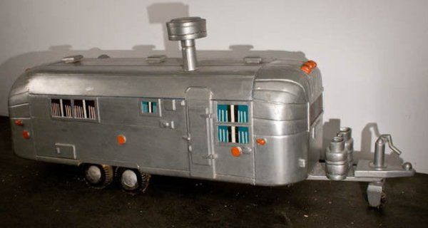 Someone is selling this Airstream coffin on eBay for $4,500. It comes from Ghana where it was made in a workshop in 1995 by Nii Anum, a disciple of Kane Kwei, a carpenter born in the 1920s who made a name for himself making custom fantasy casket in his hometown of Accra.